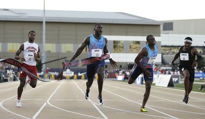 Justin Gatlin, second from left, reacts as he defeats Christian Coleman, second from right, won finished second in the men's 100 meters at the U.S. Track and Field Championships, Friday, June 23, 2017, in Sacramento, Calif. (AP Photo/Rich Pedroncelli)