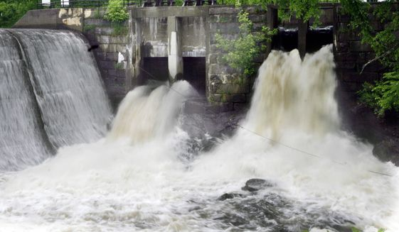 Legal professionals are debating whether the state-owned dam in Pittsfield, New Hampshire, is a public forum — which would allow for an Islamic State flag. (Associated Press)