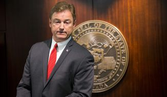 Sen. Dean Heller, Nevada Republican, announced Friday that he would vote no on his party leadership's health care bill unless changes are made. He said his state could not absorb Medicaid cuts in the plan. (Associated Press)