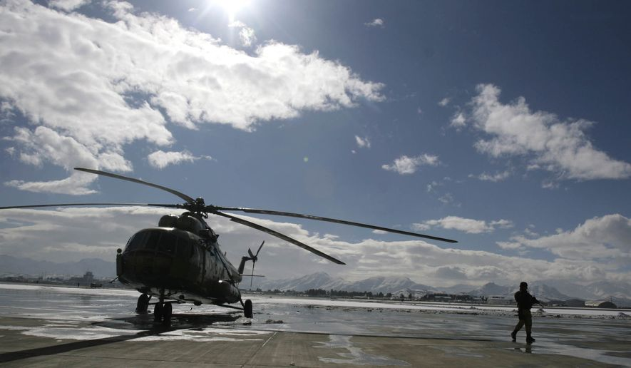 A refurbished Mi-17 helicopter was part of an opening ceremony at a military airport in Kabul, Afghanistan, in 2008, but the Russian-made chopper has proved a failure in the long war. (Associated Press/File)