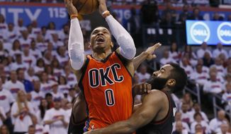 FILE - In this April 23, 2017 file photo, Oklahoma City Thunder guard Russell Westbrook (0) shoots between Houston Rockets guard Patrick Beverley, rear, and guard James Harden, right, in the fourth quarter of Game 4 of a first-round NBA basketball playoff series in Oklahoma City. Westbrook will join Houstons James Harden and San Antonios Kawhi Leonard as finalists for the leagues MVP award. The winner will be announced Monday, June 26, at the inaugural NBA Awards show. (AP Photo/Sue Ogrocki, File)