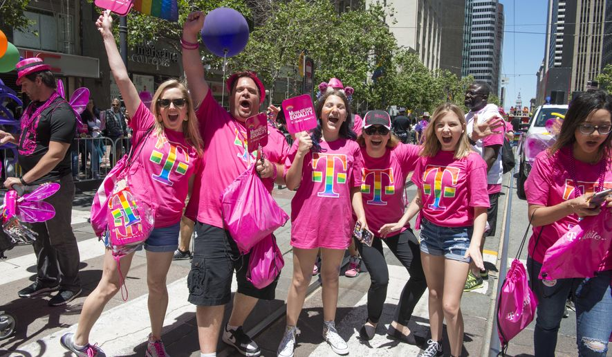 IMAGE DISTRIBUTED FOR T-MOBILE - T-Mobile employees show #UnlimitedPride as they celebrate equal rights for the LGBTQ community during San Francisco Pride on Sunday, June 25, 2017. T-Mobile was a sponsor of the event. (Peter Barreras/AP Images for T-Mobile)
