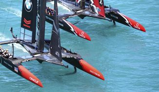 In this photo provided by America's Cup Event Authority, Emirates Team New Zealand, top, competes against Oracle Team USA during the America's Cup sailing competition in the Great Sound of Bermuda, Sunday, June 25, 2017. (Gilles Martin-Raget/ACEA via AP)