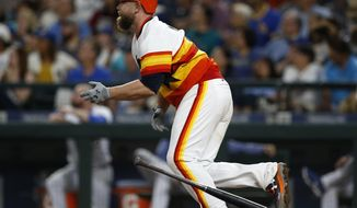 Houston Astros' Brian McCann hits a three-RBI double to score George Springer, Josh Reddick and Carlos Correa against the Seattle Mariners during the seventh inning of a baseball game Saturday, June 24, 2017, in Seattle. (AP Photo/Jason Redmond)