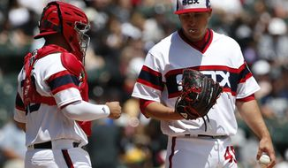 Chicago White Sox starting pitcher Derek Holland, right, listens to catcher Omar Narvaez during the first inning of a baseball game against the Oakland Athletics, Sunday, June 25, 2017, in Chicago. (AP Photo/Nam Y. Huh)
