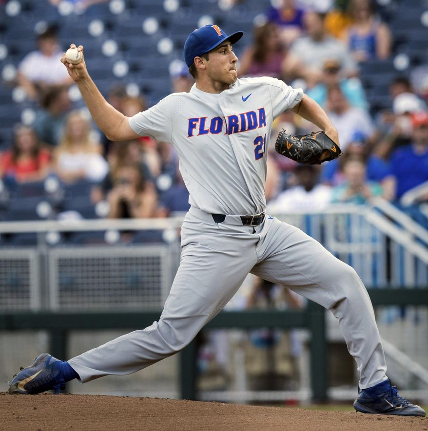 Florida's Alex Faedo (21) pitches in the bottom of the first inning during a College World Series baseball game against TCU, Saturday, June 24, 2017, in Omaha, Neb. (Ryan Soderlin/Omaha World-Herald via AP)