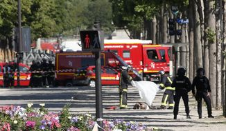FILE - In this June 19 2017 file photo, rescue workers cover the dead body of an attacker on the Champs Elysees in Paris. The jihadis' targets are depressingly repetitive: the Brussels metro (twice), Paris' Champs-Elysees (twice) and tourist-filled bridges in London (twice). And that's just the past few months. (AP Photo/Thibault Camus, File)