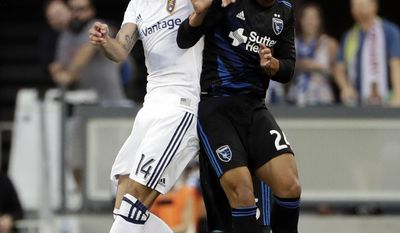 San Jose Earthquakes defender Nick Lima, right, works for a head ball next to Real Salt Lake forward Yura Movsisyan (14) during the first half of an MLS soccer match Saturday, June 24, 2017, in San Jose, Calif. (AP Photo/Marcio Jose Sanchez)