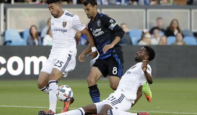 San Jose Earthquakes forward Chris Wondolowski, center, is defended by Real Salt Lake defender Aaron Maund, right, and Danilo Acosta during the first half of an MLS soccer match Saturday, June 24, 2017, in San Jose, Calif. (AP Photo/Marcio Jose Sanchez)