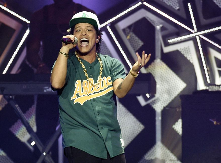 """FILE - In this Dec. 2, 2016, file photo, Bruno Mars performs at the 2016 Jingle Ball at Staples Center in Los Angeles. The """"B"""" in BET Awards could stand for Beyonce, or Bruno Mars.Both pop stars are the top nominees at Sunday's show, June 25, 2017, where they will compete in four of the same categories, including video of the year. Mars, who will open the show at the Microsoft Theater in Los Angeles, is nominated for five awards.  (Photo by Chris Pizzello/Invision/AP, File)"""