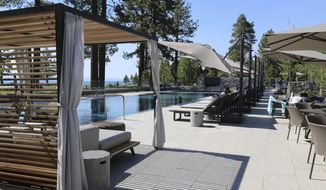 This June 20, 2017 photo released by  Douglas County shows the new swimming pool at the Edgewood Tahoe Lodge during its grand opening on the south shore of Lake Tahoe in Stateline, Nev. The $100 million lodge has 154 rooms and was built in conjunction with an ambitious project to protect wetlands and filter stormwater runoff harmful to the lake's clarity. (Melissa Blosser/Douglas County Public Information Officer via AP)