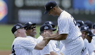 Former New York Yankee Jorge Posada, front right, shakes hands with other former players during Old-Timers' Day at Yankee Stadium, Sunday, June 25, 2017, in New York. (AP Photo/Seth Wenig)