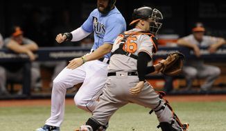 Tampa Bay Rays' Steven Souza Jr., left, beats the throw to Baltimore Orioles catcher Caleb Joseph, right, to score on Taylor Featherstone's RBI-single during the second inning of a baseball game Sunday, June 25, 2017, in St. Petersburg, Fla. (AP Photo/Steve Nesius)