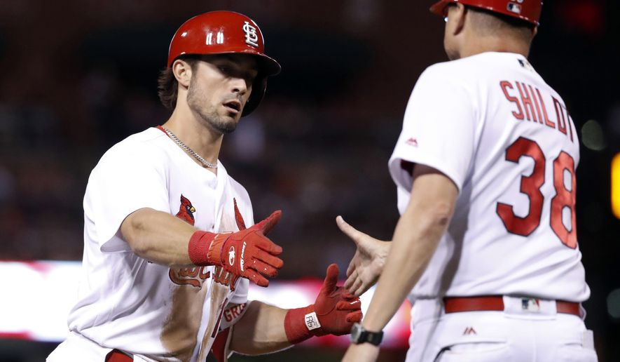 St. Louis Cardinals' Randal Grichuk, left, is congratulated by third base coach Mike Shildt after hitting a solo home run during the sixth inning of a baseball game against the Pittsburgh Pirates, Sunday, June 25, 2017, in St. Louis. (AP Photo/Jeff Roberson)