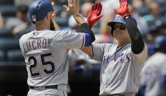 Texas Rangers' Shin-Soo Choo, right, celebrates his three-run homer with Jonathan Lucroy during the second inning of the baseball game against the New York Yankees at Yankee Stadium Sunday, June 25, 2017 in New York. (AP Photo/Seth Wenig)