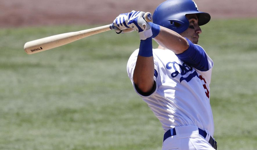 Los Angeles Dodgers' Cody Bellinger watches his two-run home run against the Colorado Rockies during the third inning of a baseball game in Los Angeles, Sunday, June 25, 2017. (AP Photo/Chris Carlson)