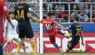 Chile's Martin Rodriguez, 2nd right, scores his side's first goal during the Confederations Cup, Group B soccer match between Chile and Australia, at the Spartak Stadium in Moscow, Sunday, June 25, 2017. (AP Photo/Ivan Sekretarev)