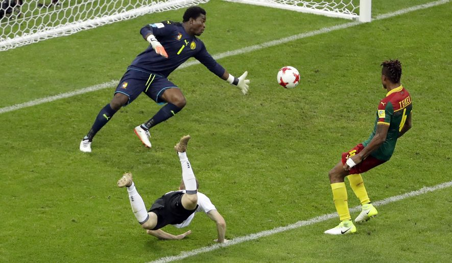 Germany's Timo Werner, front, scores his side's second goal during the Confederations Cup, Group B soccer match between Germany and Cameroon, at the Fisht Stadium in Sochi, Russia, Sunday June 25, 2017. (AP Photo/Sergei Grits)