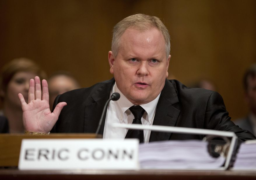 In this Oct 7, 2013, file photo, attorney Eric Conn gestures as he invokes his Fifth Amendment rights against self-incrimination during a Senate Homeland Security and Governmental Affairs committee hearing on Capitol Hill in Washington. Conn, a fugitive Kentucky lawyer at the center of a nearly $600 million Social Security fraud case, has fled the country using a fake passport and has gotten help from someone overseas with a job to help support himself, the Lexington Herald-Leader reported Sunday, June 25, 2017. (AP Photo/ Evan Vucci, File)