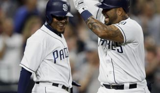 San Diego Padres' Hector Sanchez, right, celebrates his two-run home run with Erick Aybar during the eighth inning of the team's baseball game against the Detroit Tigers in San Diego, Saturday, June 24, 2017. (AP Photo/Alex Gallardo)