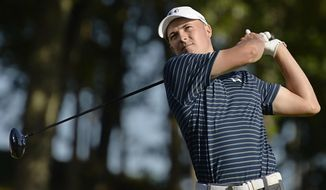 Jordan Spieth hits off the 18th tee during a playoff in the final round of the Travelers Championship golf tournament, Sunday, June 25, 2017, in Cromwell, Conn. (AP Photo/Jessica Hill)