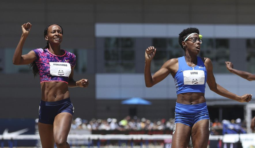 Dalilah Muhammad, left, reacts as she crosses the finish line ahead of second-place finisher Shamier Little, right, in the women's 400-meter hurdles at the U.S. Track and Field Championships, Sunday, June 25, 2017, in Sacramento, Calif. (AP Photo/Rich Pedroncelli)