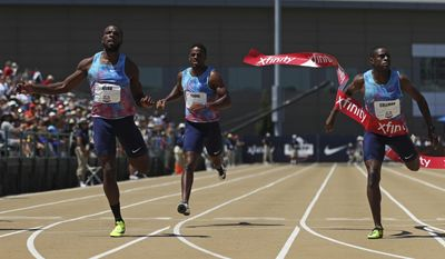 Ameer Webb, left, wins the men's 200 meters as Christian Coleman, right, comes in second at the U.S. Track and Field Championships, Sunday, June 25, 2017, in Sacramento, Calif. (AP Photo/Rich Pedroncelli)