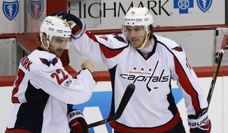 FILE - In this Monday, May 1, 2017, file photo, Washington Capitals' Kevin Shattenkirk (22) celebrates with T.J. Oshie (77) after scoring the game-winning goal in overtime of Game 3 in an NHL Stanley Cup Eastern Conference semifinal hockey game against the Pittsburgh Penguins in Pittsburgh. The Capitals committed big money to winger T.J. Oshie with a $46 million, eight-year deal, but theyre unlikely to re-sign Shattenkirk, Williams, Karl Alzner and Daniel Winnik. Shattenkirk wants to be a No. 1 defenseman and is a good bet to sign the richest contract of any free agent. (AP Photo/Gene J. Puskar, File)