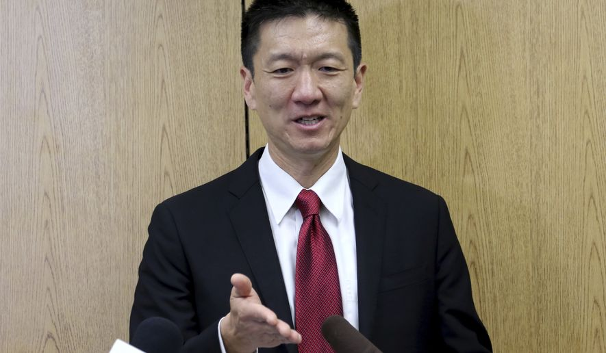 "Hawaii Attorney General Doug Chin speaks at a news conference about the Supreme Court's decision on President Donald Trump's travel ban, Monday, June 26, 2017, in Honolulu. The Supreme Court is allowing Trump to forge ahead with a limited version of his ban on travel from six mostly Muslim countries. Chin says the important thing about the decision is that the travel ban will not go into effect for people with a ""bona fide"" connection to the United States. (AP Photo/Caleb Jones)"