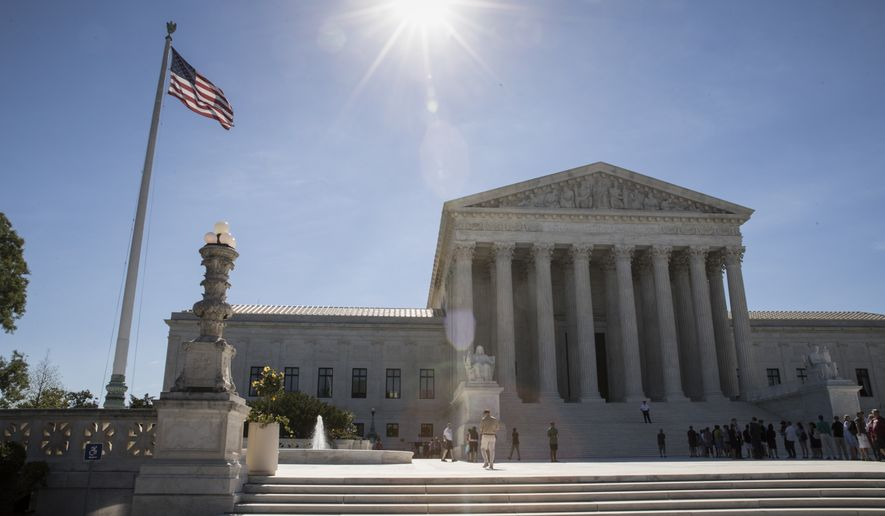 People visit the Supreme Court in Washington, Monday, June 26, 2017, as justices issued their final rulings for the term, in Washington. (AP Photo/J. Scott Applewhite)