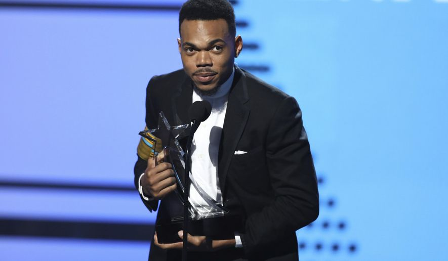 Chance The Rapper accepts the humanitarian award at the BET Awards at the Microsoft Theater on Sunday, June 25, 2017, in Los Angeles. (Photo by Matt Sayles/Invision/AP)