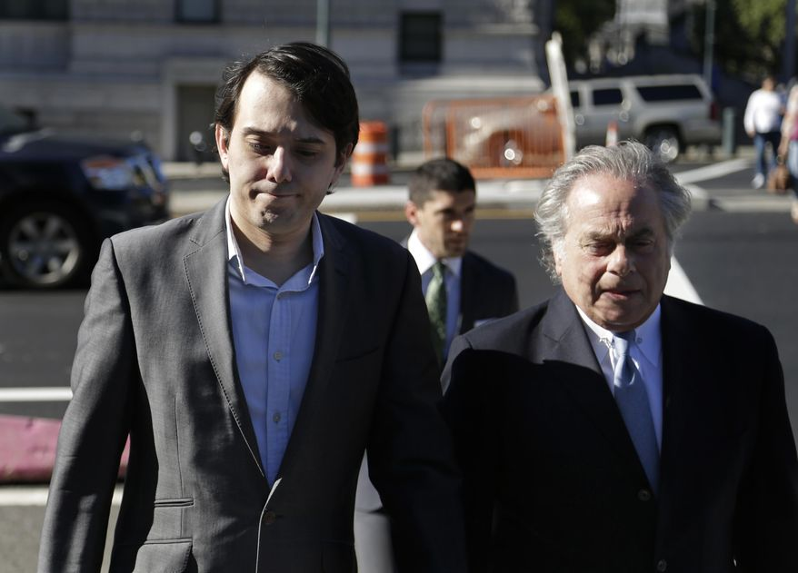 Former Turing Pharmaceuticals CEO Martin Shkreli, left, arrives to federal court with his attorney Benjamin Brafman, in New York, Monday, June 26, 2017. Even with his federal securities fraud trial set to begin Monday, Shkreli has blatantly defied his attorneys' advice to lay low. (AP Photo/Seth Wenig)