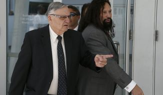 Former Maricopa County Sheriff Joe Arpaio, left, leaves U.S. District Court on the first day of his contempt-of-court trial with attorney Mark Goldman, right, Monday, June 26, 2017, in Phoenix. (AP Photo/Ross D. Franklin)