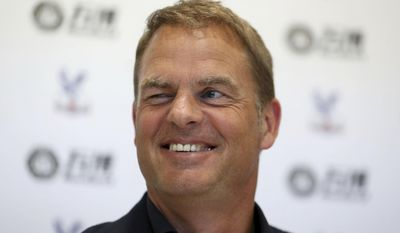 Frank De Boer smiles during a press conference at Beckenham Training Ground, Kent, Monday June 26, 2017. Former Netherlands defender Frank de Boer has been hired as manager of Crystal Palace, taking his first coaching job in English soccer seven months after getting fired by Inter Milan. (Steven Paston/PA via AP)