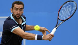 Croatia's Marin Cilic returns a ball to Spain's Feliciano Lopez during their final match at The Queen's Club tennis tournament in London, Sunday June 25, 2017. (Steven Paston/PA via AP)