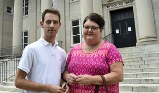 """In this Friday, May 19, 2017 photo, Matthew Fenner stands with his aunt, Lynn Rape, outside the Rutherford County Courthouse after a hearing on his case against Word of Faith Fellowship church in Rutherfordton, N.C. Fenner, a former church member, said he was kidnapped and assaulted by members because he is gay. In December 2014, a grand jury indicted five church members. """"If it wasn't for our pressure,"""" Rape said, """"nothing would have happened."""" (AP Photo/Kathy Kmonicek)"""