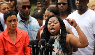 In this Friday June 16, 2017, file photo, Valerie Castile, mother of Philando Castile, a black motorist who was killed by Officer Jeronimo Yanez, speaks about her reaction to a not guilty verdict for Yanez at the Ramsey County Courthouse in St. Paul, Minn. Valerie Castile reached a nearly $3 million settlement in Philando Castile's death, announced Monday, June 26, by attorneys for Valerie Castile and the city of St. Anthony. (Renee Jones Schneider/Star Tribune via AP, File)