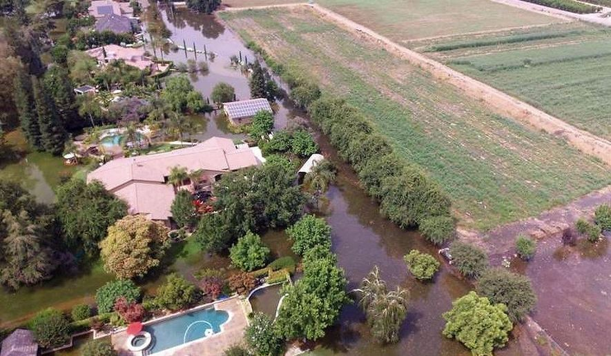 This June 25, 2017, photo taken by an unmanned aerial vehicle and released by the Tulare County Sheriff's Office shows flooding from the Kings River at the Kings River Golf and Country Club in Kingsburg, Calif. Authorities say 90 homes remain under mandatory evacuation orders following levee breaches along the Kings River in Central California. The Kings River began to flood Wednesday about 25 miles (40 kilometers) north of Fresno as temperatures soared, melting snow in the Sierra Nevada and sending it downstream. (Tulare County Sheriff's Office via AP)