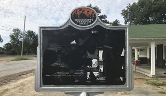 In this June 2017 photo, released by Allan Hammons, a civil rights historical marker in Money, Miss. is seen. The marker remembers black teenager Emmett Till, who was kidnapped before being lynched in 1955. Allan Hammons, whose public relations firm made the marker, said Monday that someone scratched the marker with a blunt tool in May.(Allan Hammons via AP)
