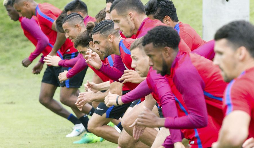 U.S. Men's National Team soccer players warm up before a training session at Lipscomb University in Nashville, Tenn., on Monday, June 26, 2017. The team is preparing for a friendly against Ghana on July 1 and the opening of the Gold Cup tournament against Panama on July 8. (AP Photo/Erik Schelzig)