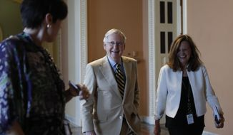 """Senate Majority Leader Mitch McConnell of Ky., center, talks with his chief of staff Sharon Soderstrom, right, and communications staff director Antonia Ferrier, left, as they walk to his office on Capitol Hill in Washington, Monday, June 26, 2017. Senate Republicans unveil a revised health care bill in hopes of securing support from wavering GOP lawmakers, including one who calls the drive to whip his party's bill through the Senate this week """"a little offensive."""" (AP Photo/Carolyn Kaster)"""