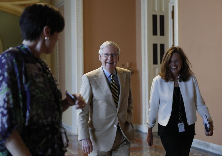 "Senate Majority Leader Mitch McConnell of Ky., center, talks with his chief of staff Sharon Soderstrom, right, and communications staff director Antonia Ferrier, left, as they walk to his office on Capitol Hill in Washington, Monday, June 26, 2017. Senate Republicans unveil a revised health care bill in hopes of securing support from wavering GOP lawmakers, including one who calls the drive to whip his party's bill through the Senate this week ""a little offensive."" (AP Photo/Carolyn Kaster)"
