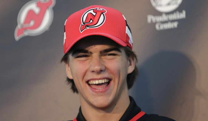 New Jersey Devils' Nico Hischier laughs during a news conference in Newark, N.J., Monday, June 26, 2017. The 18-year-old center was the first Swiss-born player to be drafted first overall in the NHL draft. (AP Photo/Seth Wenig)