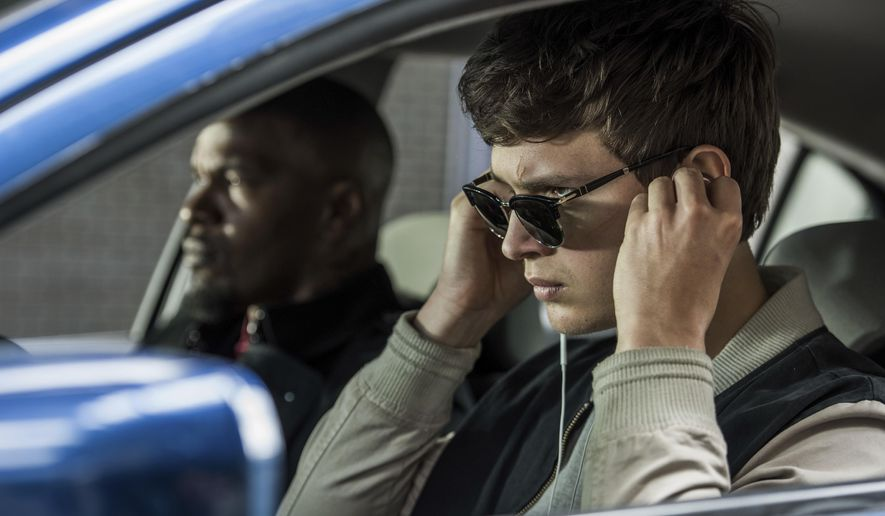 "This image released by Sony Pictures shows Ansel Elgort, right, and Jamie Foxx in a scene from ""Baby Driver."" (Wilson Webb/Sony/TriStar Pictures via AP)"