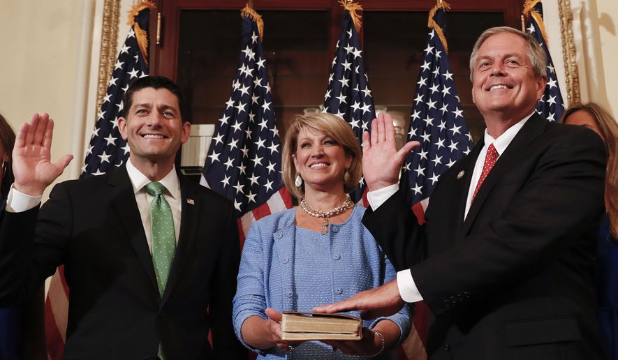 Speaker of the House Paul Ryan, R-Wis., left, Representative-elect Ralph Norman, R-S.C., right and his wife Elaine Rice Norman, center, participate in a ceremonial swearing-in on Capitol Hill in Washington, Monday, June 26, 2017. Norman, a staunch conservative, had a 3 percentage point victory last week in a South Carolina race in a district that went for President Donald Trump last year by 18 percentage points. (AP Photo/Carolyn Kaster)