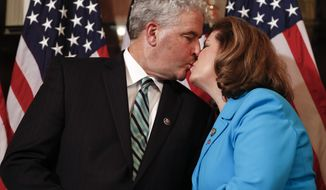 Representative-elect Karen Handel, R-Ga., right, kisses her husband Steve Handel before a ceremonial swearing-in on Capitol Hill in Washington, Monday, June 26, 2017. Handel, the Republican winner of the most expensive House race ever, is preparing to take her seat representing Atlanta's outskirts, along with a South Carolina Republican who claimed a narrower-than-expected victory to retain a strongly Republican seat. (AP Photo/Carolyn Kaster)