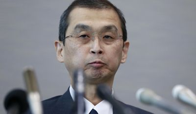 Japanese air bag maker Takata Corp. CEO Shigehisa Takada listens to a reporter's question during a press conference in Tokyo, Monday, June 26, 2017. Takata has filed for bankruptcy protection in Tokyo and the U.S., overwhelmed by lawsuits and recall costs related to its production of defective air bag inflators. (AP Photo/Shizuo Kambayashi)