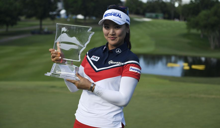 So Yeon Ryu, from South Korea, holds up her trophy for photographers after winning the LPGA Wal-Mart NW Arkansas Championship golf tournament at Pinnacle Country Club in Rogers, Ark., Sunday, June 25, 2017. (AP Photo/Michael Woods)