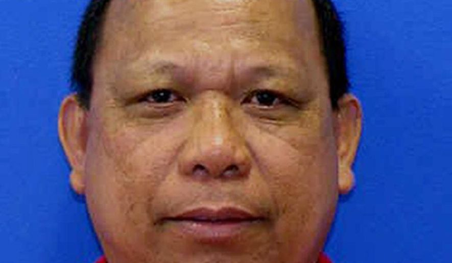 FILE - This photo provided by the Maryland Motor Vehicle Administration shows Eulalio Tordil. Former federal officer Tordil pleaded guilty on Monday, June 26, 2017, to killing his wife Gladys Tordil on May 5, 2016, in the parking lot of a high school in Beltsville where she was picking up her daughters. (Maryland Motor Vehicle Administration via AP, File)