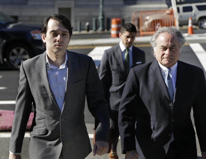 Former Turing Pharmaceuticals CEO Martin Shkreli, left, arrives to federal court with his attorney Benjamin Brafman in New York, Monday, June 26, 2017. Even with his federal securities fraud trial set to begin Monday, Shkreli has blatantly defied his attorneys' advice to lay low. (AP Photo/Seth Wenig)
